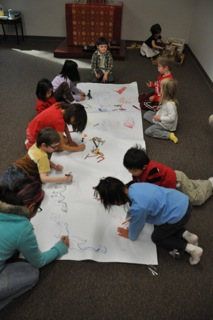 children working on a poster